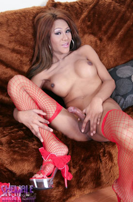 t asian ladyboy ploy 03 Asian Ladyboy Ploy Is Fetching In Red On Shemale Club!